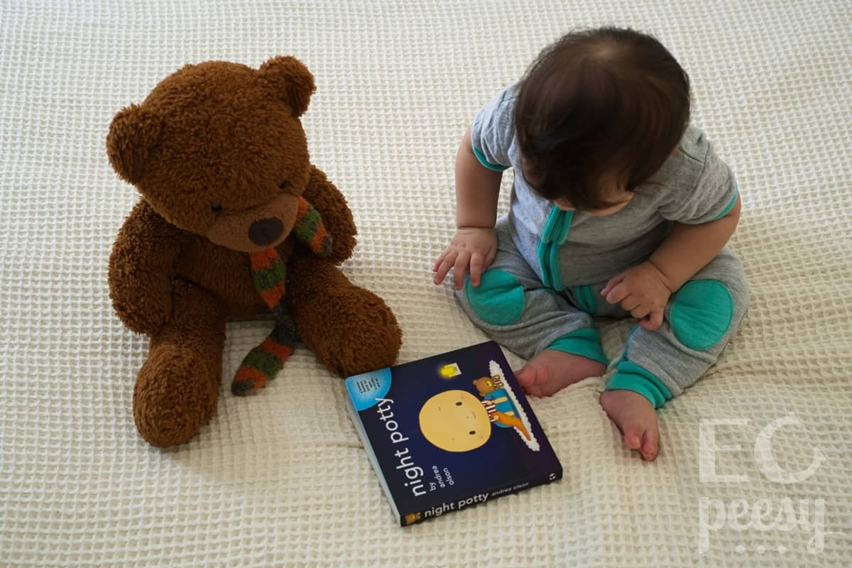 Wearing Baby DeeDee Sleepsie Short Sleeve and Reading Night Potty
