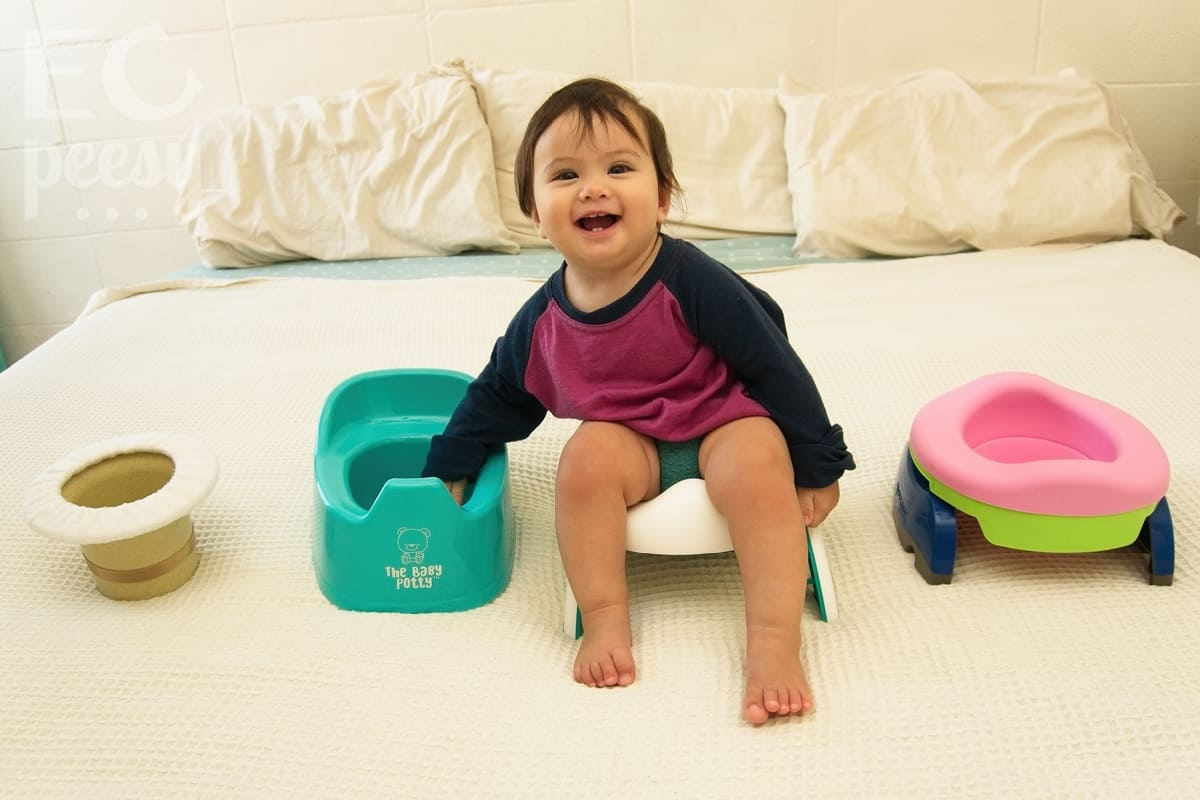 Baby Sitting on the OXO Tot 2-in-1 Go Potty for Travel