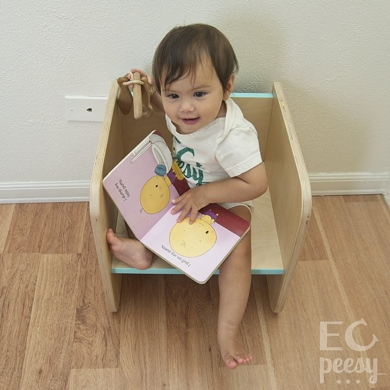 Toddler Sitting on Montessori Cube Chair